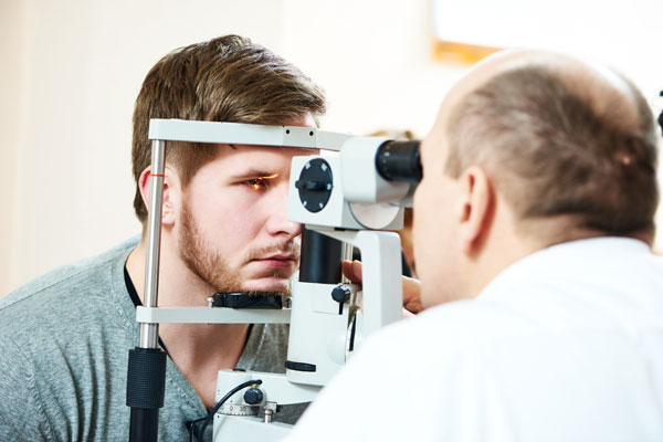 bigstock-Male-optometrist-optician-doct-92340083-(1)